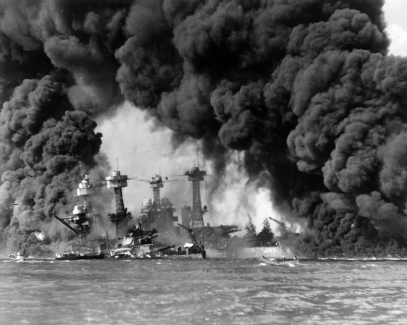 Battleships burn after Japanese Air Raids on Pearl Harbor Naval Base. Photo courtesy Wikimedia/National Archives.