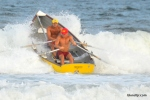 A doubles pair from Wildwood Beach Patrol crashes a wave during the Doubles Rowing event at the Tri-Resorts Lifeguard Races on July 13, 2015 in Sea Isle City.
