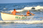 A Doubles Rowing team from Sea Isle City Beach Patrol crosses the finish line during the Doubles Rowing event at the Tri-Resorts Lifeguard Races on July 13, 2015 in Sea Isle City.