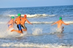 Lifeguards from Sea Isle City, Upper Township and Wildwood enter the ocean to compete in the Individual Swim event during the Tri-Resorts Lifeguard Races on July 13, 2015 in Sea Isle City.