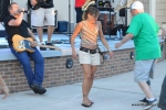 Concert-goers dance to the music as the BStreetBand performs at Excursion Park on July 18, 2015 in Sea Isle City.