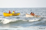 Lifeguards from Wildwood and Sea Isle City approach the finish line in the Mixed Doubles Row event at the Tri-Resort Lifeguard Races on July 13, 2015 in Sea Isle City.