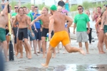 Sea Isle CIty lifeguard Matt Smith approaches the finish line to win the Team Surf Dash at the Tri-Resorts Lifeguard Races on July 13, 2015 in Sea Isle City.